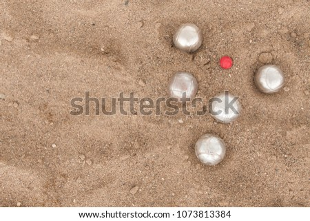 Beach. A game of Bocha. Brilliant silver balls for a bocha on the sand. #1073813384