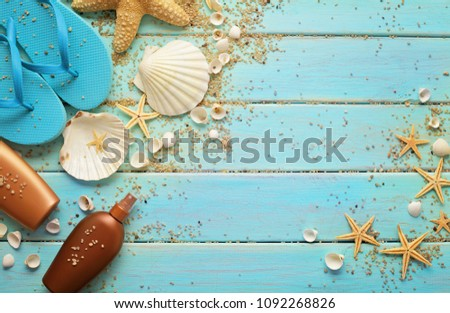 beach accessories and seashells on wooden board #1092268826