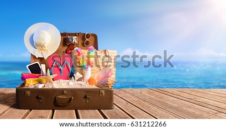 Beach Accessories In Suitcase On Beach - Travel Concept  #631212266