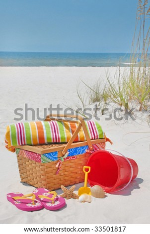 Beach accessories on sand at beautiful seashore - stock photo