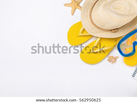 Beach accessories on white background, vacation and travel items, top view