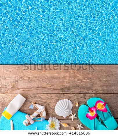 beach accessories on wooden...