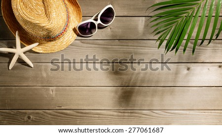 Beach accessories on wooden board #277061687