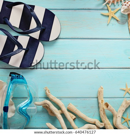 beach accessories on wooden board #640476127
