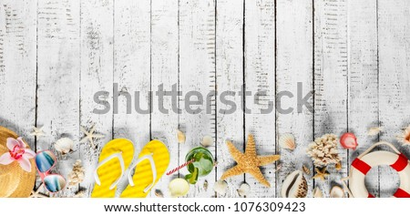 Photo of Beach accessories placed on white wooden planks, top view. Summer holidays concept, free space for text. Very high resolution image