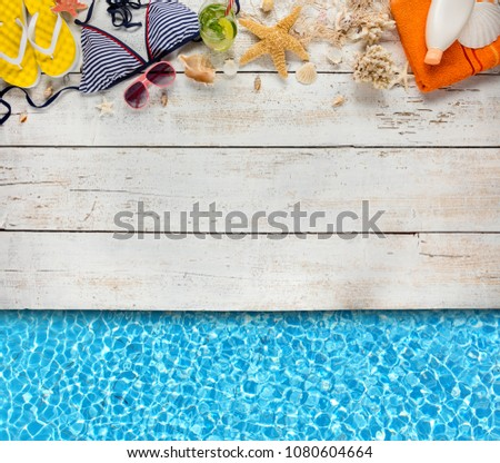 Photo of Beach accessories placed on white wooden planks with swimming pool water surface, top view. Summer holidays concept, free space for text. Very high resolution image
