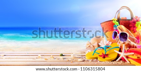 Beach Accessories With Seashells On Wooden Deck In Sunny Seashore - Summer Holidays #1106315804