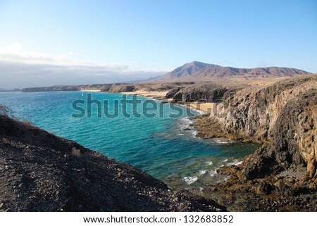 Beach and bay, Lanzarote, Spain - View of a beautiful bay and beach at the Playas de Papagayo, Lanzarote, Canary Islands, Spain.