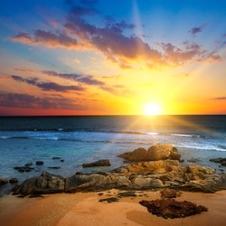 Beach and beautiful sunrise. The concept is travel.