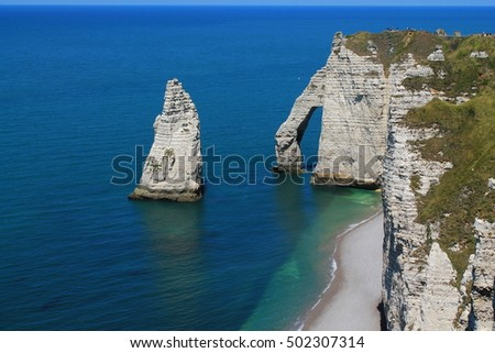 Beach and cliffs of Etretat, a tourist and farming norman french town #502307314