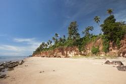 Beach and red cliffs.