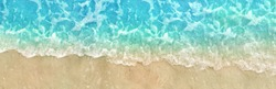 Beach and Sand Summer Blue Water Washing Up on Shore Horizontal Panoramic Texture Photography Background, Close Up Shot from Directly Above
