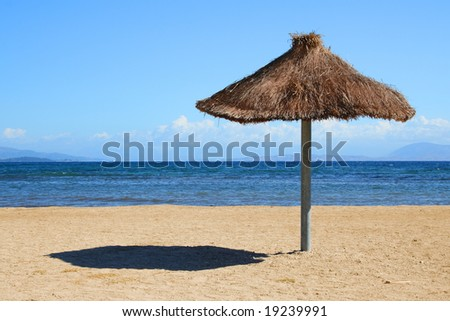 Beach and sea. Sunshade with chairs on sand