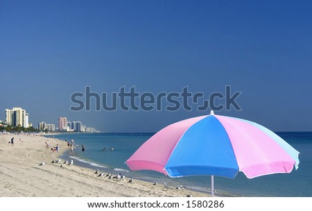 beach and umbrella at fort lauderdale florida, with condos in background
