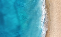 Beach and waves from top view. Turquoise water background from top view. Summer seascape from air. Top view from drone. Travel concept and idea