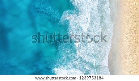 Beach and waves from top view. Turquoise water background from top view. Summer seascape from air. Top view from drone. Travel concept and idea #1239753184
