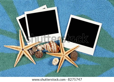 Beach background with beach towel, starfish, shells and blank polaroid prints