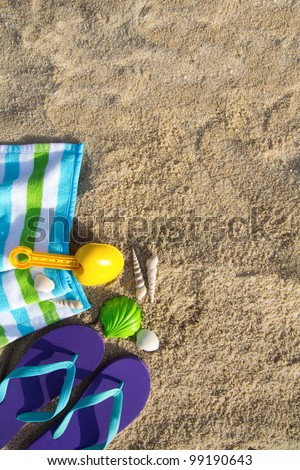 Beach background with flip flop, towel and plastic spade