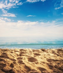 Beach background with sand, ocean and sky