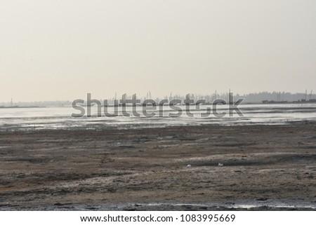 Beach backwater mud, mud background, mud backdrops #1083995669