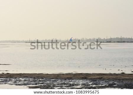 Beach backwater mud, mud background, mud backdrops #1083995675