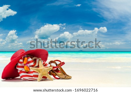 Beach bag hat and starfish at the tropical beach Stock photo ©