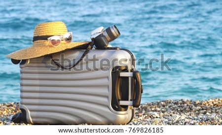 Beach bag on sand. Summer vacation and travel concept - Shutterstock ID 769826185