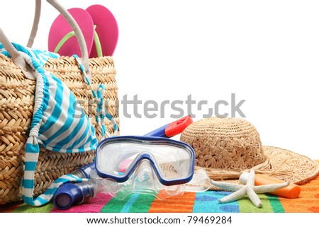 beach bag with swimming suit and diving equipment.Isolated on white background.