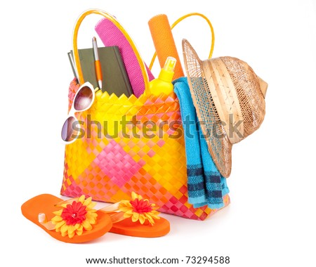 beach bag with towel sunglasses flip-flops and hat.isolated on white