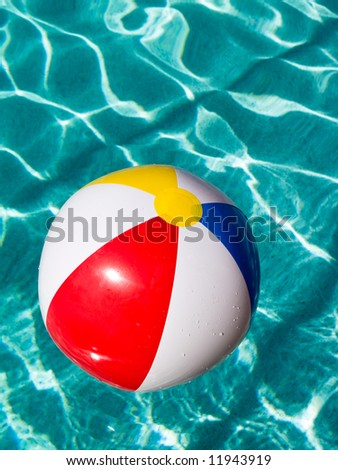 Pool Water With Beach Ball beach ball floating in swimming pool. stock photo 11943919