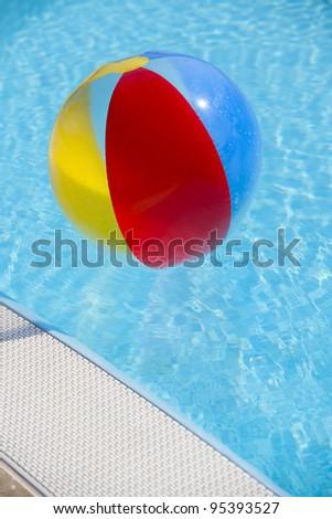 Beach ball on swimming-pool