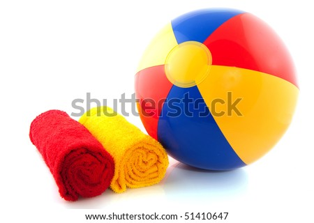 Beach ball with rolled towels on white background