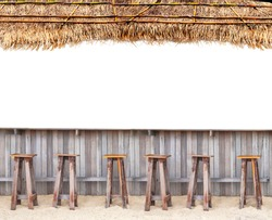 beach bar with wood chair on sand and thatched roof tropical hawaii concept on white isolated background for site advertising  with white place for text