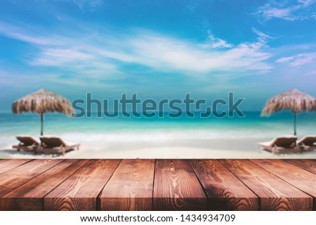 Beach bar wood table composition. Sunbed  in front of  bar and sea. Travel ocean holiday. Manipulation ready. Typography ready. #1434934709