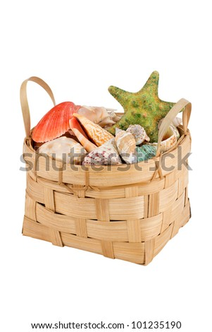Beach basket full of shells and seafishes over white background