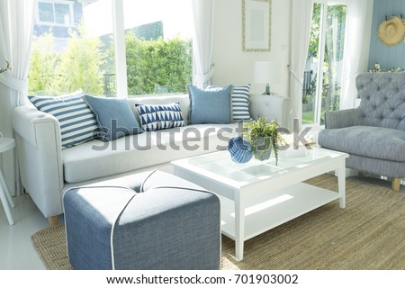 Photo of  beach blue cushion and sofa of coastal home