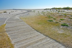 Beach Boardwalk: A wooden path invites visitors to the beach at Assateague Island National Seashore.