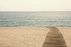 Beach Boardwalk sunset in Playa de Aro, Catalonia, Spain