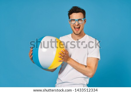 beach caucasian guy attractive summer beautiful leisure portrait leisure blue studio mobile man lifestyle play relaxation isolated for adults shirt shorts fun people joyful