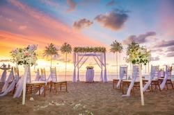 beach ceremony setup with colorful sky