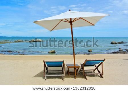Beach chair and umbrella on idyllic tropical sand beach. Phuket, Thailand #1382312810