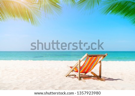 Beach chair on the tropical beach in Thailand with blue sky in sunny day. Summer vacation and holiday. #1357923980