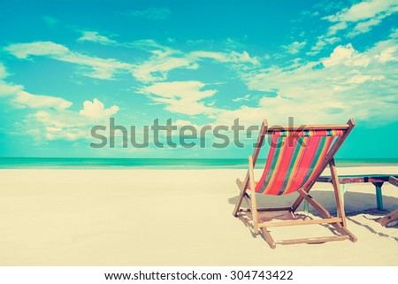 beach chair on white sand beach ...