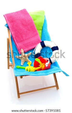 beach chair with colorful towels and toys over white background
