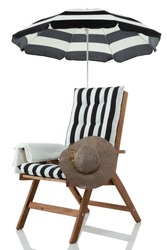Beach chair with umbrella, hat and towel