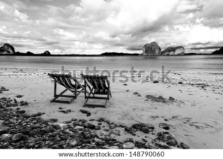 Beach chairs and beautiful beach on black and white tone