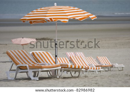 Beach chairs and umbrella