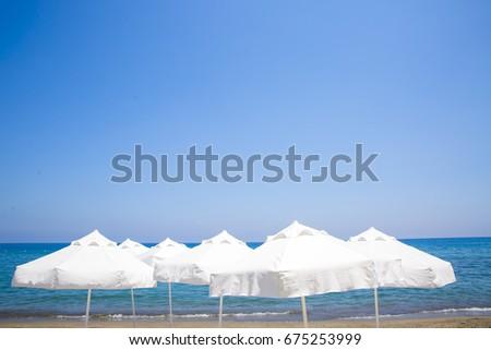 beach chairs and umbrellas on sand beach #675253999