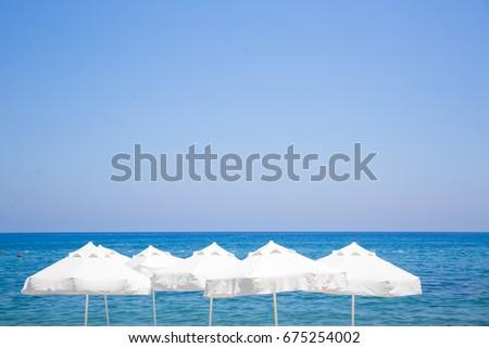 beach chairs and umbrellas on sand beach #675254002