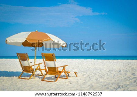 Beach Chairs at the Shore #1148792537